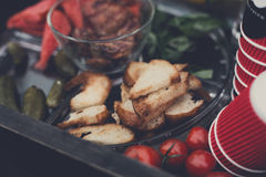 Street food market, grilled barbecue meat, picnic. Street food market. Grilled Barbecue meat, roasted toasts and vegetables, picnic, shallow depth of field Royalty Free Stock Photos