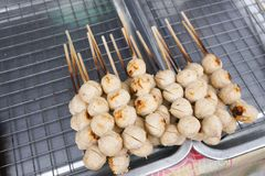 Street food meat ball sticks on grill stock photography