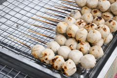 Street food meat ball sticks on grill royalty free stock photography
