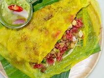 Street food name Banh xeo. Close up Street Food - Vietnamese Pancake Banh Xeo Stock Photography