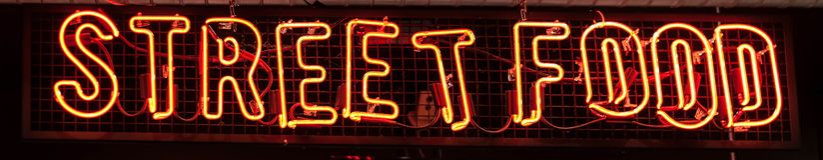 Street Food Neon sign on a Graffiti. Bricks wall. Street Food Neon sign on a Graffiti. sign street food stock image