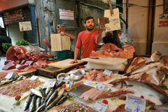 Street food in Palermo, Italy with tuna fish seller in a market