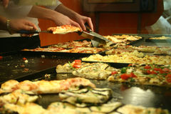 Street food pizza. Handmade italian by the slice pizza pool Royalty Free Stock Images