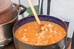 Street food - pot full of pork stew Stock Photography