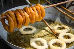Traditional Peruvian sweets picarones. Street food preparation - traditional Peruvian sweets picarones royalty free stock image