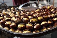 Street food. roast chestnuts Royalty Free Stock Image