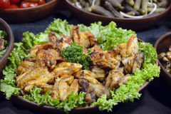 Street food. Roasted chicken wings are on food stall. Christmas fair in Ukraine stock photo