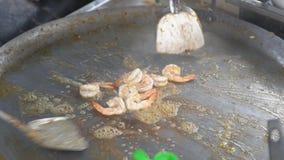 Street Food, Roasting shrimps on a pan stock footage
