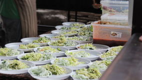 Street food - salad served on disposable plates stock footage