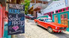 Street food in sayulita town,near punta mita,mexico. Street food and a red mustang in the fishing and surf town of sayulita near punta mita ,mexico Royalty Free Stock Photos