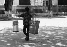Street food seller, Hanoi. Woman food seller walking the streets of Hanoi royalty free stock photo