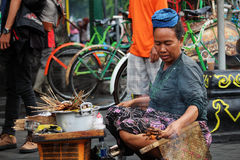 Street food seller in Malioboro street. A lady selling street food in the most central and touristic street of Yogyjakarta, Indonesia Royalty Free Stock Photo