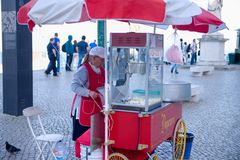 Street food seller selling corn. Lisboa Portugal – april 2015 : An unidentified local merchant woman selling corn Stock Images