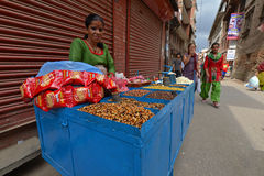 Street food seller selling corn and nuts Royalty Free Stock Image