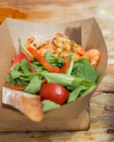 Street food shrimps served with vegetables closeup Royalty Free Stock Images