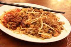 Street food Singapore. Fried noodle cha kway tiew with delicious and spicy taste Stock Photos