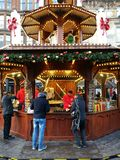 Street food stall on Christmas market. People buying food at strwet food stall on Christmas market in Glasgow, UK Royalty Free Stock Images