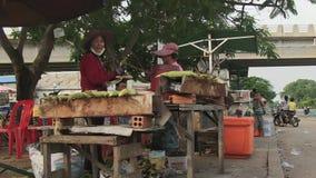 Street food,  sweet corn, cambodia, southeast asia stock video footage