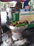 Street food in thailand. Slow cooked pork and vegetables cooking in a big pot. Thailand has wonderful street food royalty free stock photo