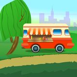 Street food truck with an umbrella for a cafe in the central park. royalty free stock photo