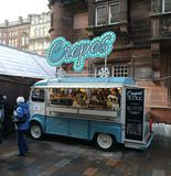Street food van selling crepes. A vintage street food van selling french crepes on Christmas market in Glasgow, UK Royalty Free Stock Photography
