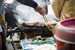 Street food vendor. A food vendor selling grilled chicken on the street of bangkok, thailand Stock Images