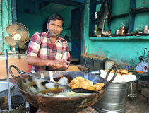 Street Food Vendor, Agra, India. A man preparing food to fry in his stall. Agra, Uttar Pradesh, India Stock Photos