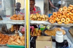Street food vendor behind the showcase. Asia food stall. royalty free stock photos