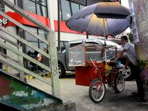 Street food vendor on a bicycle stock images