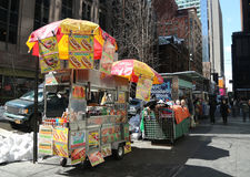 Street food vendor cart in Manhattan. NEW YORK - MARCH 16, 2017: Street food vendor cart in Manhattan. There are about 4,000 mobile food vendors licensed by the Stock Images