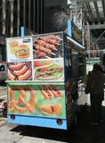 Street food vendor cart in Manhattan. NEW YORK - MARCH 16, 2017: Street food vendor cart in Manhattan. There are about 4,000 mobile food vendors licensed by the Stock Image