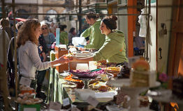 Street food vendor passing food to a women. Located in St. Nicks market bristol, uk Royalty Free Stock Photo