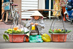 Street food vendor in the street of Ho Chi Minh, Vietnam. Royalty Free Stock Photography