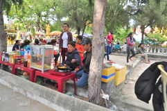 Street food vendors are serving people in the lunar new year in Vietnam Royalty Free Stock Photos