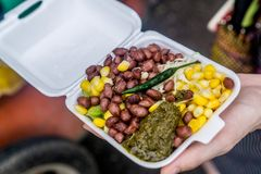 Yangon, Myanmar. Street food in Yangon, Myanmar - Beans, corn, pepper chutney, lime, salt, and other greens stock photo