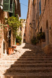Street of Fornalutx. Steep street in a mountain village in Mallorca Royalty Free Stock Photo