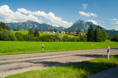 Street in front of the alps Stock Photos