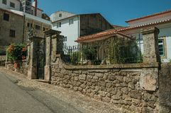 Street in front of charming old house at Monsanto. Street and stone wall with wrought iron gate in front of charming old house, on a sunny day at Monsanto stock photography