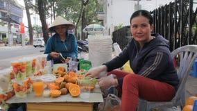 Street fruit juice sellers stock video