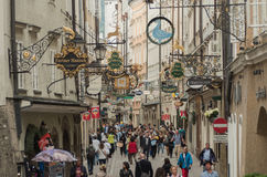 The street full of shops and antiques signs in Salzburg Stock Photos