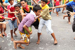 Street Games. Lucena City, Philippines - May 26: Unidentified youngters participate in the coconut race May 26, 2011, Lucena city, Philippines. Street games is a stock images