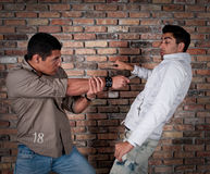 Street gang members. Young guys fighting in the street with knifes Stock Image