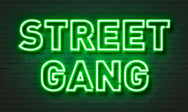 Street gang neon sign on brick wall background. Street gang neon sign on brick wall background Royalty Free Stock Images