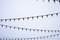 Street garland on a cloudy sky background Royalty Free Stock Photography