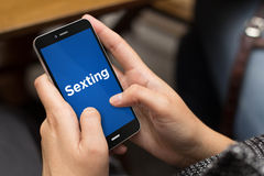 Street girl sexting stock photography