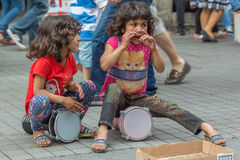 Street girls playing tambourines Stock Photo