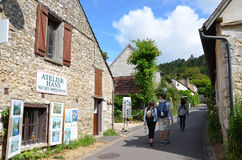 Street in Giverny, France. GIVERNY, FRANCE - AUG 5:  Tourists walk down a street in Giverny, France, home of artist Claude Monet, on August 5, 2016 Royalty Free Stock Images