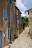Street in Gordes, Provence. Street with blue painted doors and windows in historical hilltop village Gordes in Provence, France Stock Image