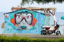 Street graffiti art depicting woman face at public beach of Limassol,Cyprus Stock Photography