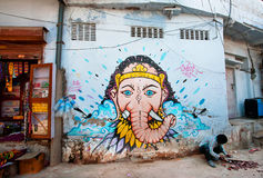 Street graffiti with Lord Ganesh on the blue wall Stock Images